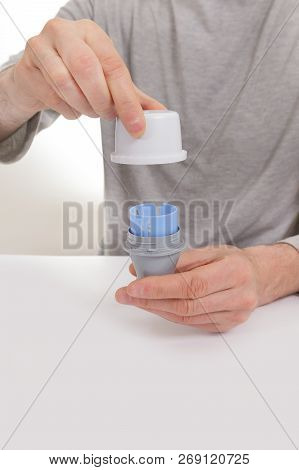 Man testing glucose level with a digital glucometer, sensor checkup glucose levels without blood. Diabetes treatment. stock photo