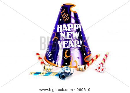 a happy new years hat with some noise makers on a white background stock photo