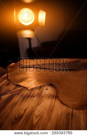 Leather craft on wooden background. Tanners workshop stock photo