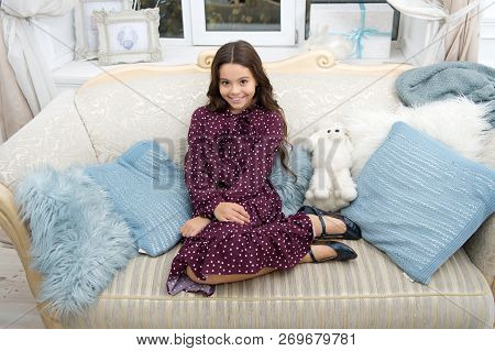 little child girl wait for xmas present. happy new year. Sweet home. waiting for santa. Kid with toys. small girl playing. . christmas family holiday. The morning before Xmas. Home interior. happy stock photo