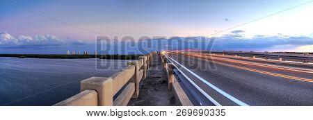 Light trails along Bridge along Estero Boulevard, crossing over New Pass from Estero Bay in Bonita Springs, Florida. stock photo