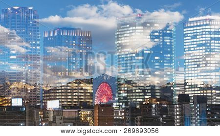 Double exposure modern buildings and nature landscape, mountain with blue sky and white cloud stock photo