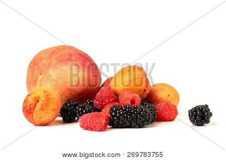 Peach, apricot, BlackBerry and raspberry isolated on white backg stock photo