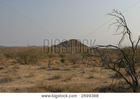 single hill landmark on a namibian farmland Africa stock photo
