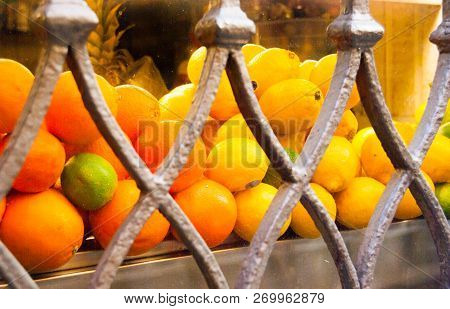 Groups of three kind of citrus fruits and metal decorations of a showcase stock photo