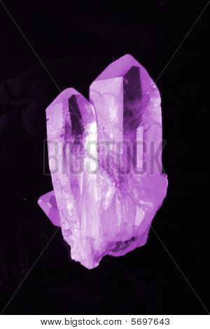 violet amethyst isolated on the black background stock photo