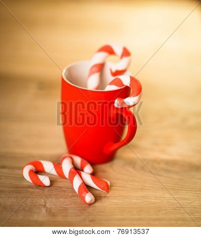 Mug Of Tea Or Coffee. Sweets. Christmas Decorations. Red Balls And Bells. Wooden Background. stock photo