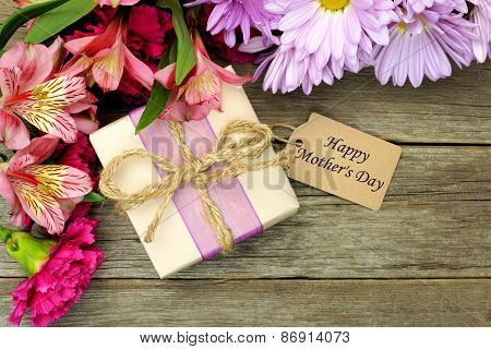 Mother\'s Day gift box and flowers on wood