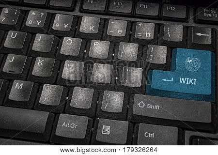 Close-up view on blue button wiki conceptual keyboard stock photo