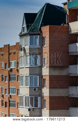 Brick house with balconies air conditioning satellite dish stock photo