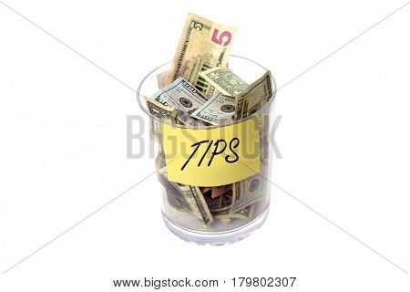 Tip Jar stuffed with money. Isolated on white with room for your text. Tip jar with sign. charity jar  stock photo