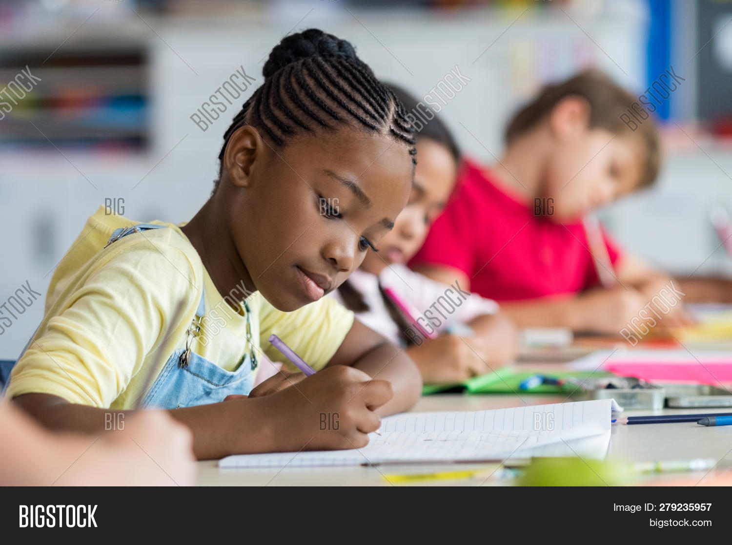 absorbed,academic,african,african girl,american,black,child,children,class,classmate,classroom,classroom students,concentrated,desk,education,elementary,elementary school,elementary students,girl,kid,kids,knowledge,learn,lesson,lessons,multi ethnic group,notebook,people in a row,primary,pupil,scholar,school,school children,school girl,schoolchild,schoolgirl,sitting,student,students,study,studying,test,writing,writing notes,writing paper,young