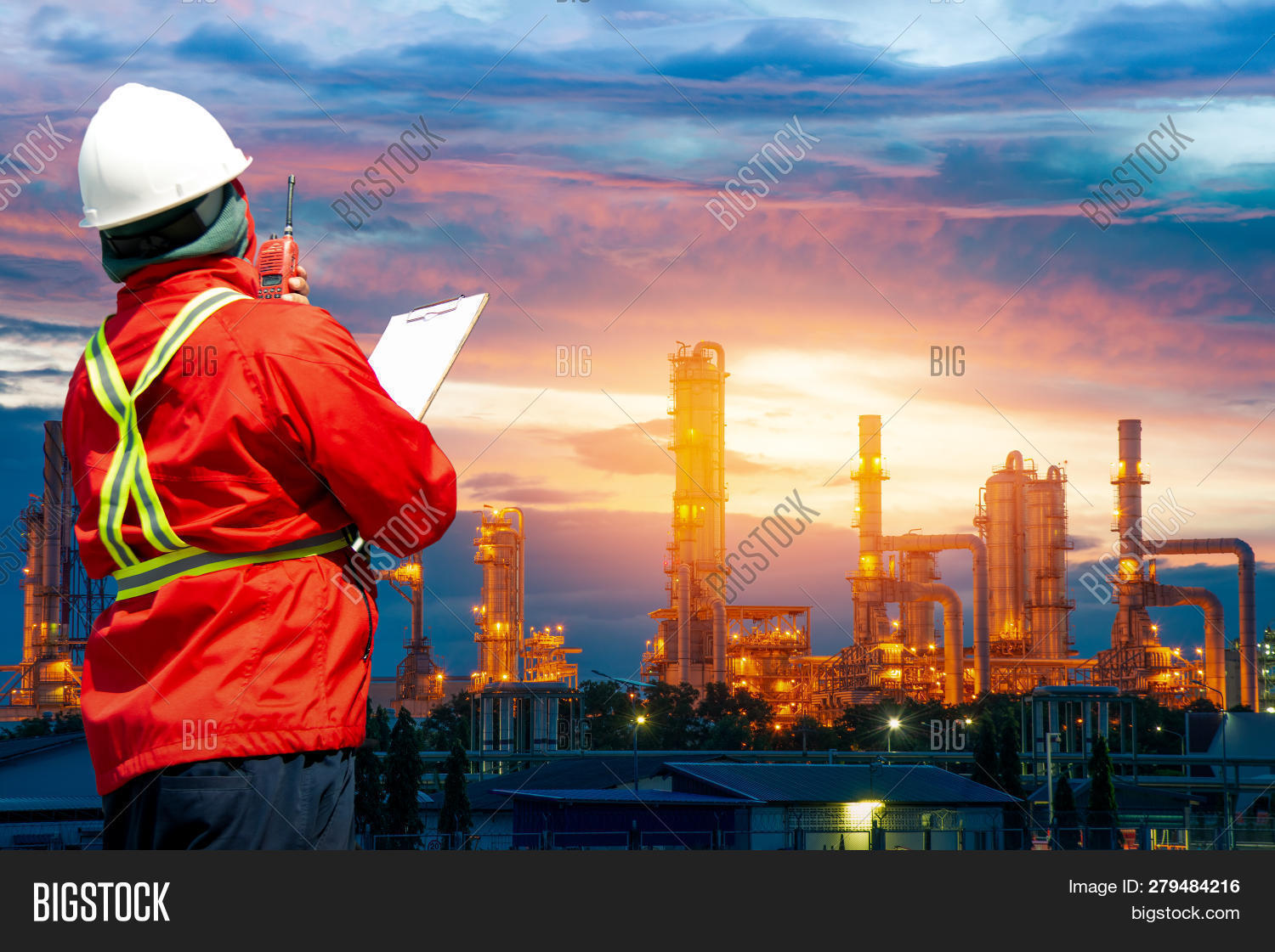 Engineering Man With White Safety Helmet Standing In Front Of Oil Refinery Building Structure In Hea