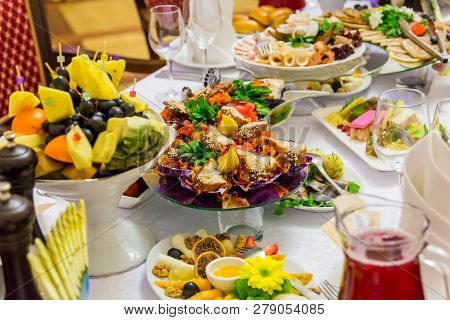 Delicacies, snacks and fruit on the festive table in the restaurant. Celebration. Catering. Banquet table. stock photo