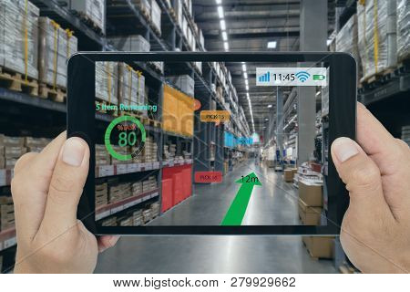 smart retail concept, A customer can check what data of real time insights into shelf status which report on a tablet from artificial intelligence(ai) smart glasses while scanning goods, price stock photo