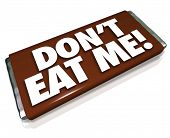 The words Don't Eat Me on a chocolate piece of candy wrapper letting you know this is unfortunate ga