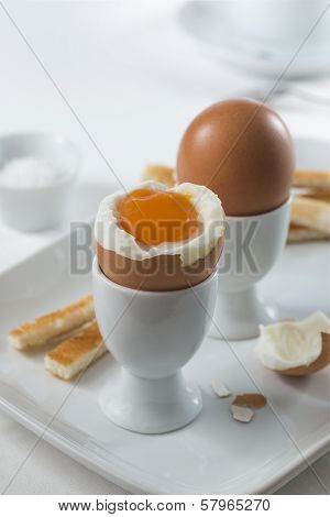 Two fresh brown soft-boiled eggs for breakfast stock photo