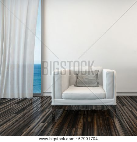 Armchair on a wooden parquet floor alongside a curtained window with a view of the sea in a living room interior stock photo