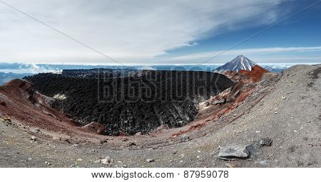 Beautiful panoramic volcanic landscape of active volcano of Kamchatka Peninsula: view of crater Avachinsky Volcano on background scenic cone Koryak Volcano on a sunny day. Russia Far East Kamchatka. stock photo