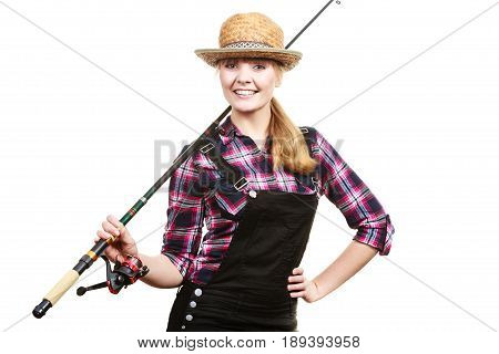 Spinning angling cheerful fisherwoman concept. Happy woman in sun hat holding fishing rod having fun and smiling. stock photo