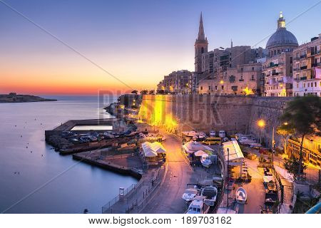 Valletta Skyline with churches of Our Lady of Mount Carmel and St. Paul's Anglican Pro-Cathedral, at dawn, Valletta, Capital city of Malta stock photo