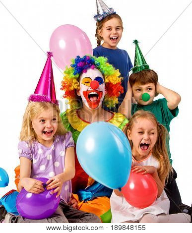 Birthday child clown playing with children and bunny fingers prank. Kid holiday cakes celebratory and balloons the happiest birthday. Fun of group people pose for camera on white background. Holiday stock photo