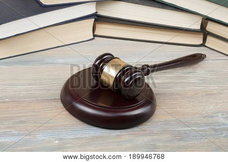 Books and wooden judges gavel on the table in a courtroom office. Law concept. stock photo