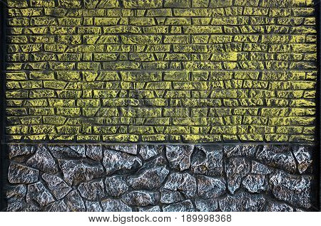 Fence texture of elongated colored stones in warm colors. Weathered stained modern fence type. Colored relief concrete wall stock photo