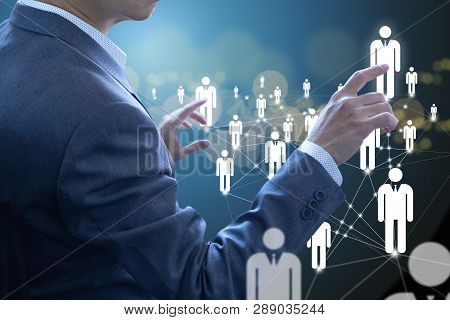 Business administrator in action of manpower or human resource planning or business organisation on a virtual dashboard. stock photo