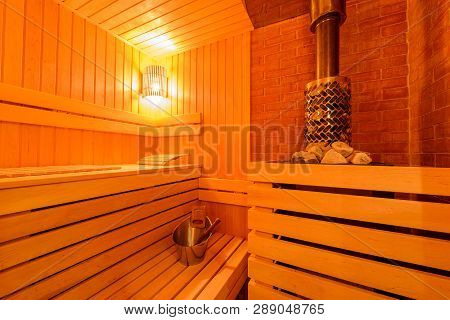 Small home Finnish wooden sauna, spa room. Relax in a hot sauna, Finland-style classic wooden sauna interior in public building, hotel. stock photo