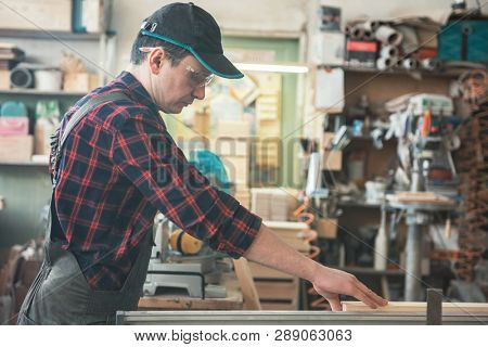Carpenter planed wooden block with electric machine stock photo