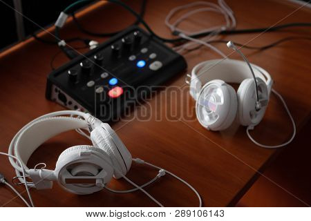 headphones and audio mixer equipment for simultaneous translation. translators workplace with specialized audio recording and transmiting system. stock photo