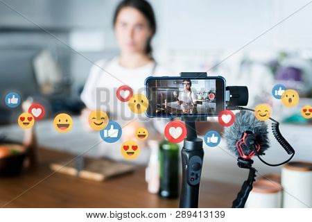 Food vlogger recording a video