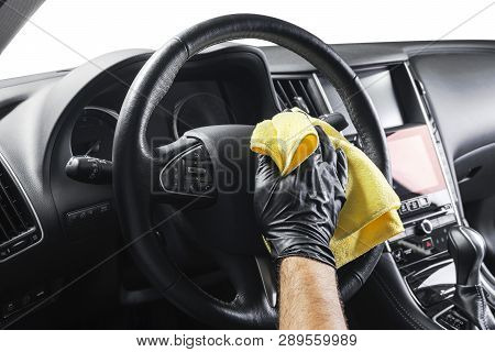 A man cleaning car with yellow microfiber cloth. Car detailing or valeting concept. Selective focus. Car detailing. Cleaning with sponge. Worker cleaning. Car wash concept solution to clean stock photo
