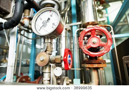Closeup of manometer, pipes and faucet valves of heating system in a boiler room stock photo