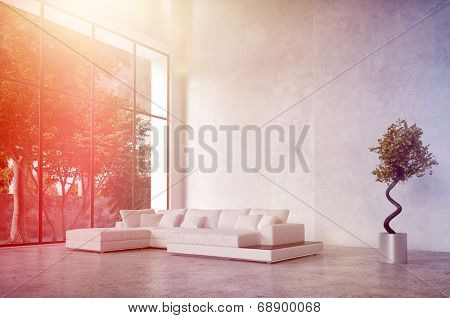 Modern living room interior with bright sun flare through a floor-to-ceiling glass wall bathing a comfortable corner unit lounge suite in bright light stock photo