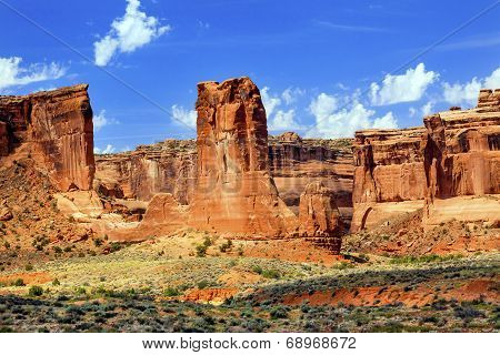 Red Orange Sheep Rock Tower of Babel Formations Canyon Arches National Park Moab Utah USA Southwest. stock photo