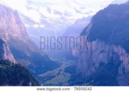 Lauterbrunnen Valley (Switzerland, Jungfrauregion) seen from the Resort Village of Wengen on Summer Evening stock photo
