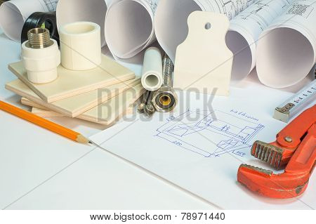 Drawing rolls, builder's level, tceramic tiles, tile drill bits, filling knife, pencil, tape measure, gas trench, pipi joints, flexible tap hose, bathroom sketch stock photo