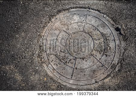 A round grille sewage wells to drain rain and melt water stock photo