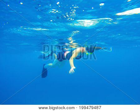 Female freediver swiming in the ocean stock photo