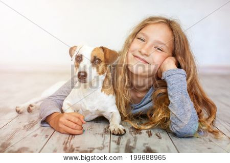 Happy child with dog. Portrait girl with pet stock photo