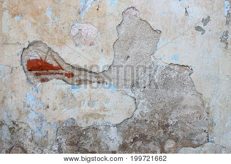 Old brick wall. The crumbling wall of bricks. Wall texture background. The plaster on the wall. Uneven wall surface. The paint on the wall. Plastered walls. Abstract background. Painted brick wall stock photo