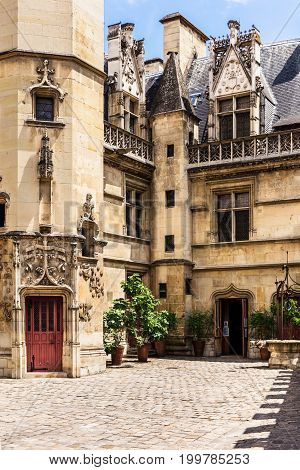 View of the courtyard of the Cluny museum (Musee de Cluny) or National Museum of the Middle Ages (Musee national du Moyen Age) in the Hotel de Cluny. The Musee de Cluny houses a variety of important medieval artifacts. Paris France stock photo