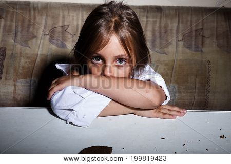 Child abuse. Poor child in slum begging you for help concept for poverty or hunger people, stock photo
