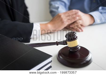 Judge gavel with lawyers advice legal at law firm in background. Concepts of law services. stock photo
