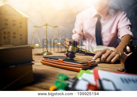 Young lawyer help his customer about buy new home tax and loan concept hardworking in the office with vintage hipster picture style. stock photo
