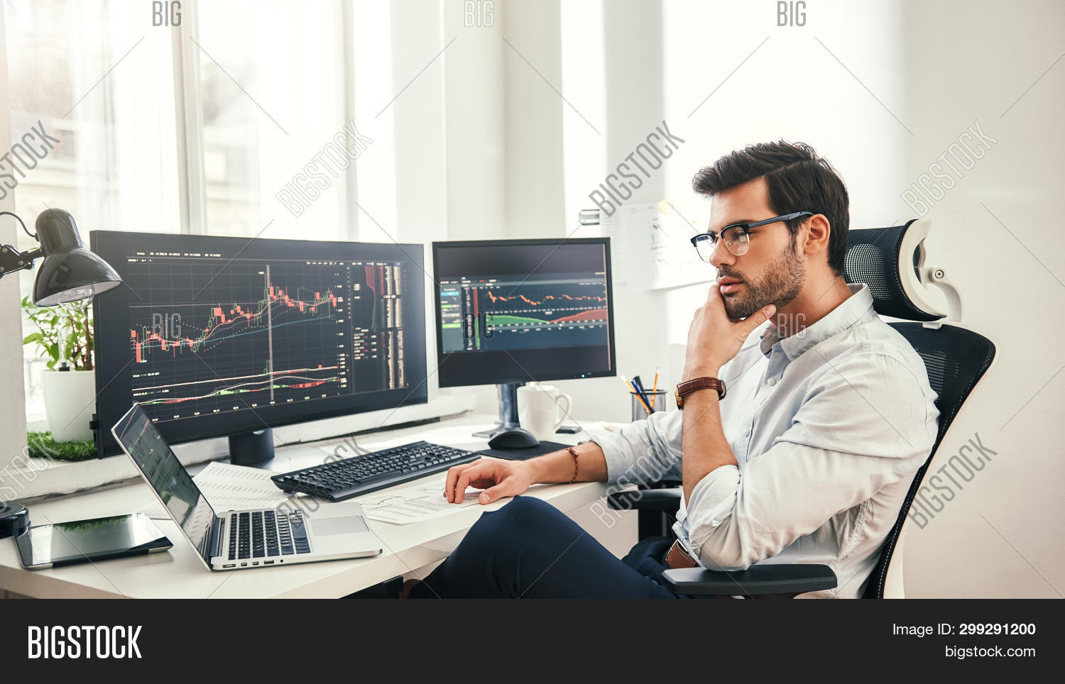 Trading Online. Successful And Young Bearded Trader In Eyeglasses And Formal Wear Working With Lapto