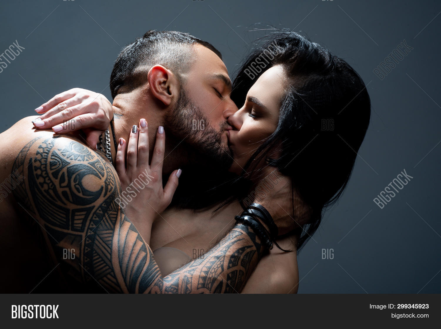 Passionate couple kissing. Romantic couple kissing. sexy couple in love. love and romance. valentines day. Young lovers. i love you. kissing couple. desire and temptation. hot relationship.