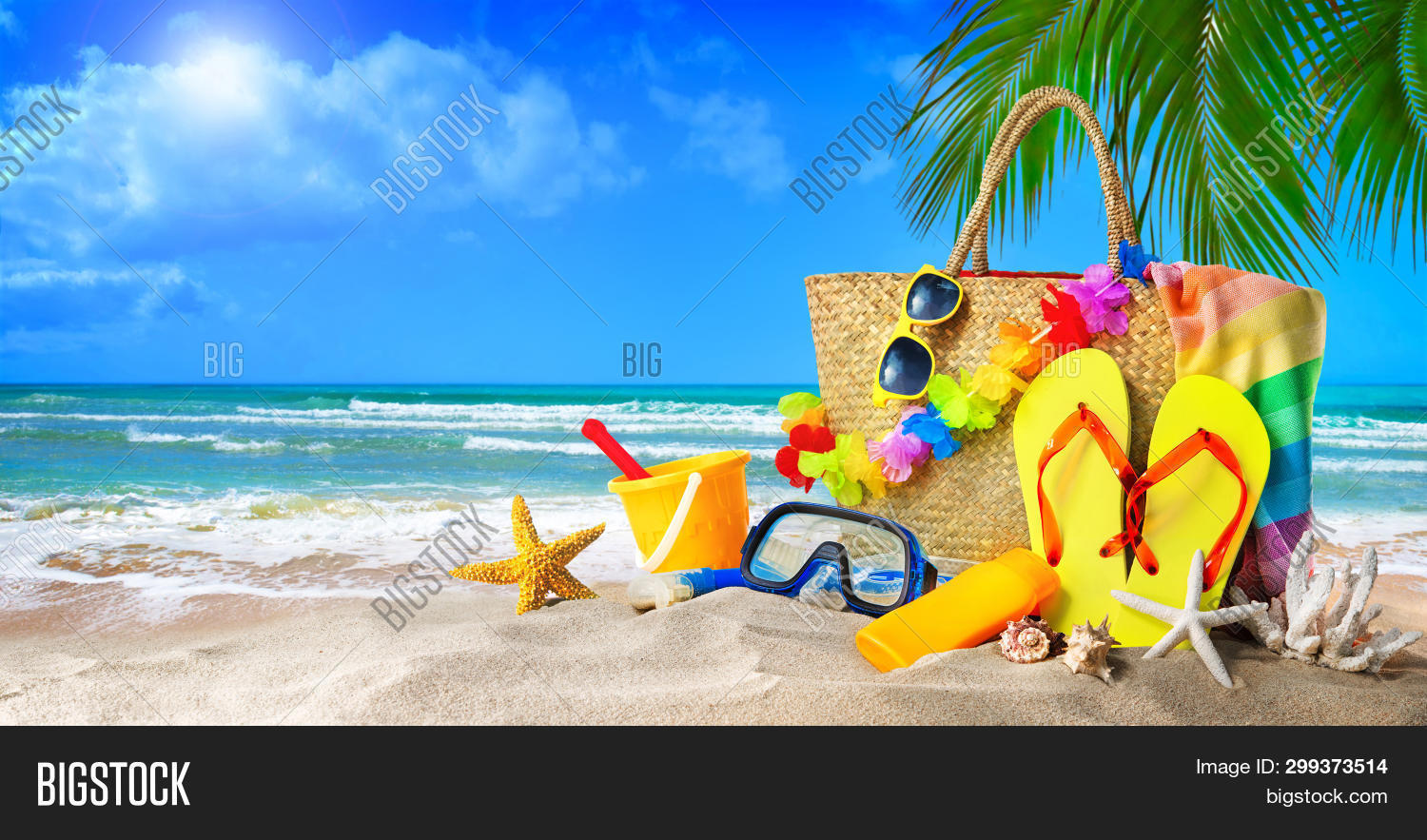 Tropical beach with sunbathing accessories, summer holiday background. Travel and beach family vacat